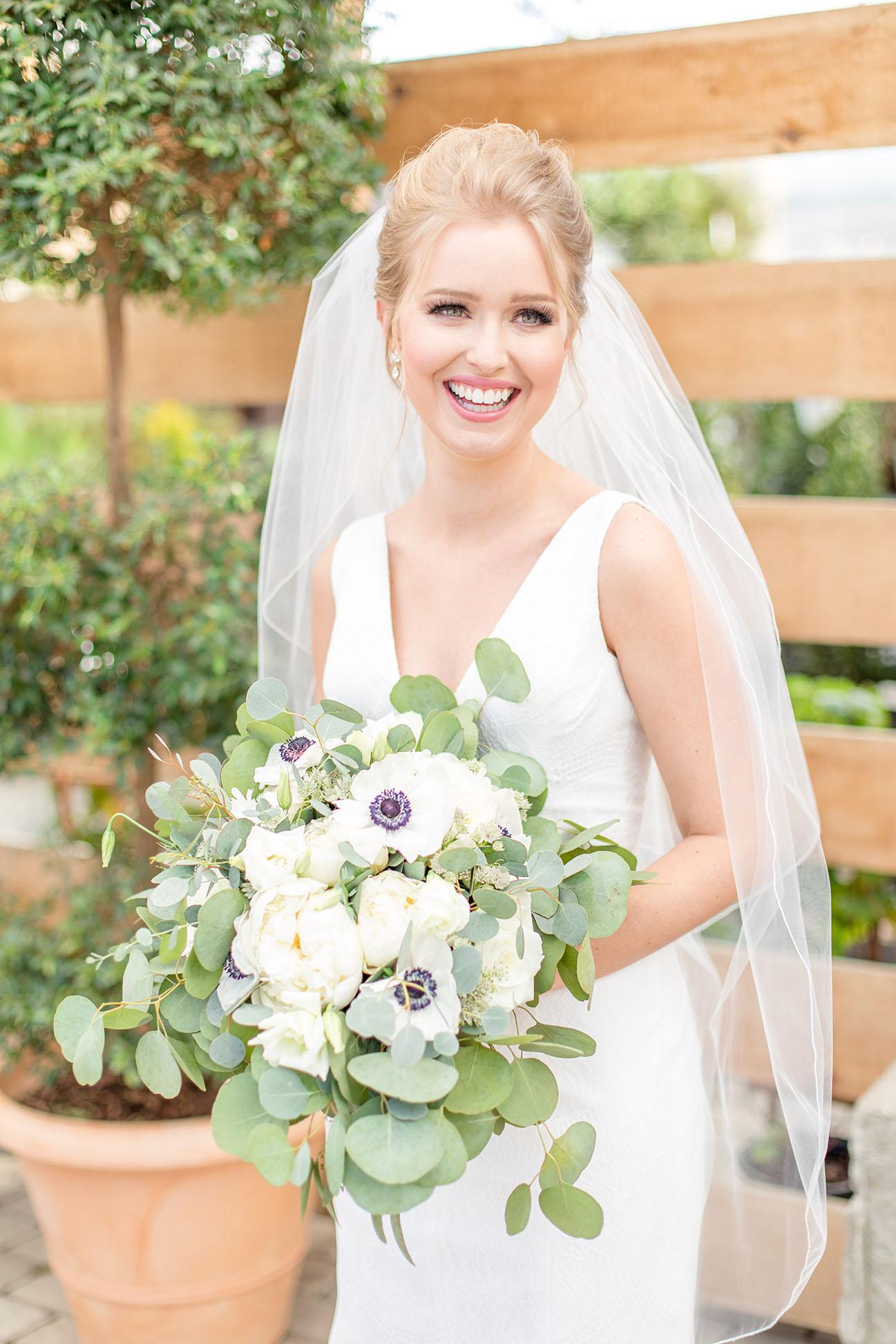 Caroline Holding Simple White Bouquet