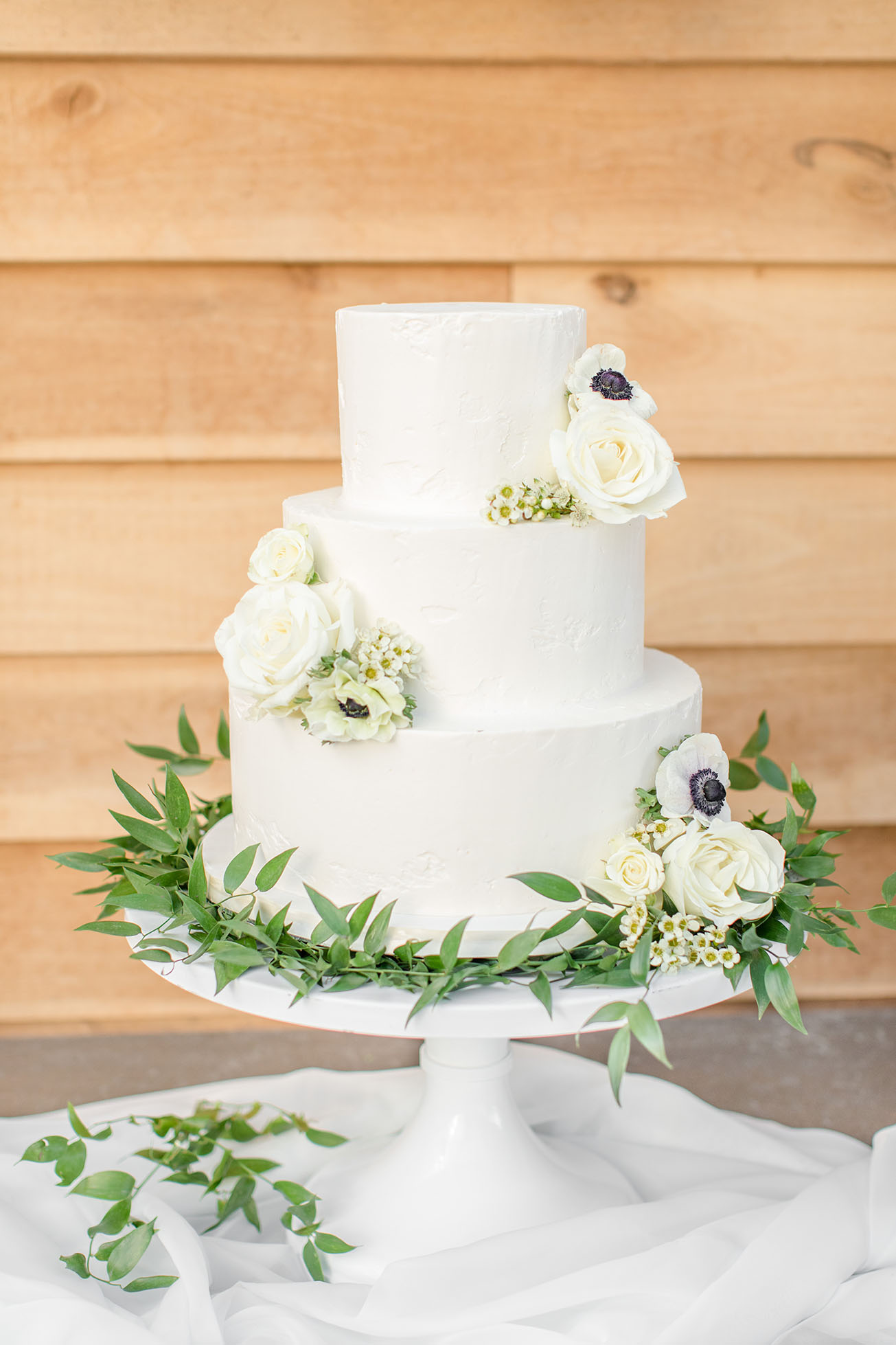 Three Tiered White Frosted Wedding Cake