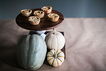 Mini Pies With a Pumpkin and Gourd Display