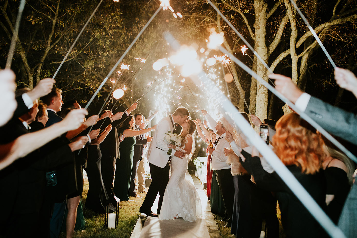 Jessie and Tim Kissing During Sparkler Wedding Exit