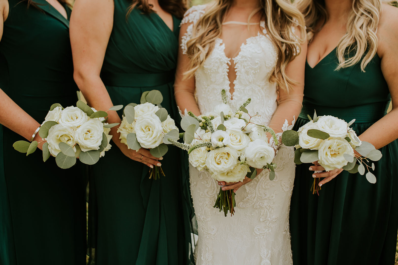 Bride and Bridesmaids Holding Wedding Bouquets